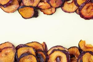 View of dried plum slices on a white background photo