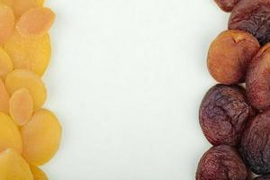 Top view of dried apricots on white background with copy space