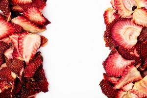 Top view of dried strawberry slices on a white background photo