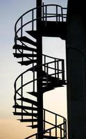 Spiral staircase at sunset