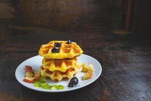 Waffles on wooden surface