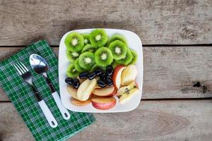 Fruit on a plate with silverware