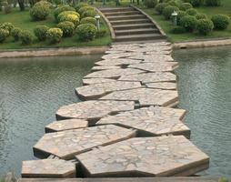 Thailand, 2020 - Stone bridge in beautiful garden photo