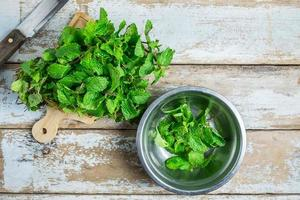 Mint herbs on a wooden table photo