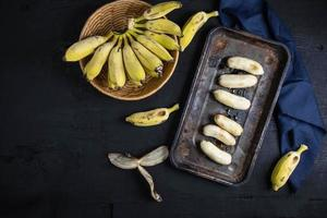 Top view of bananas on dark background