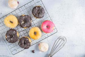 Donuts on a white wood background photo