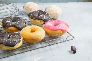 Assorted donuts on cooling rack