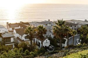 White concrete houses near sea during daytime