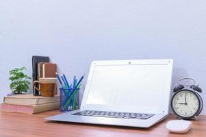 Laptop on the office desk photo