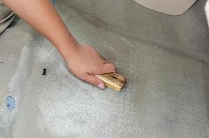 Washing the car carpet photo