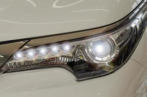 Head light on a white car