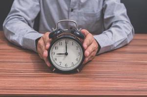 Man with an alarm clock photo