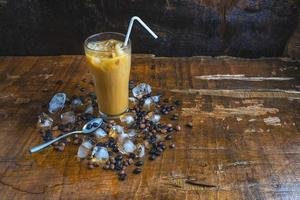 iced coffee with coffee beans and ice