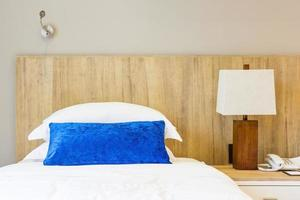 Hotel bed with blue pillow