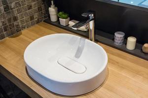 Round sink on wooden vaniety