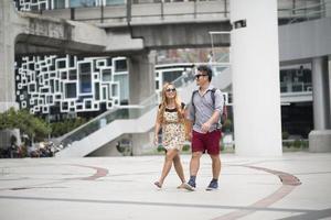 Happy couple in love walking in the street photo