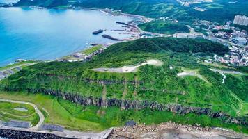 Green hill near the ocean photo