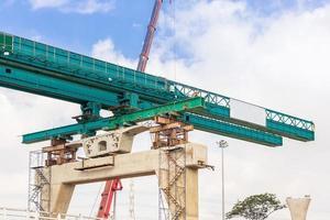 Bridge construction with a crane