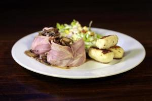 Colombian special dish stuffed ham rolls photo