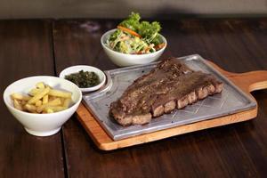 Steak on metal photo