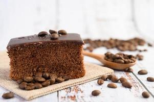 Chocolate cake with coffee beans on a wooden table