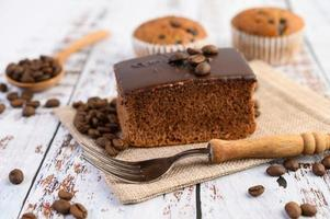 Chocolate cake and coffee beans with a fork