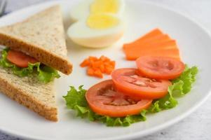 Boiled egg with tomatoes and carrots photo