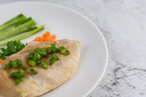 Steamed chicken breast with spring onions and chopped carrots