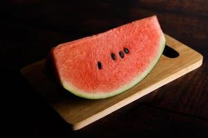 Cut watermelon on chopping board