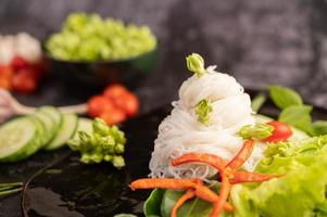 Rice noodles on a black plate photo