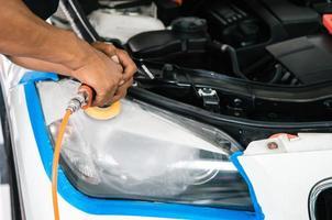 Polishing the car headlight photo