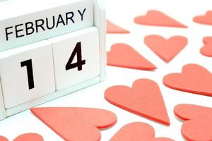 Wooden calendar February 14 with red hearts photo