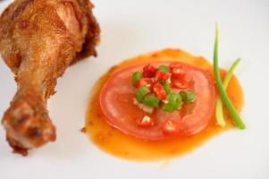Fried chicken legs with sauce photo