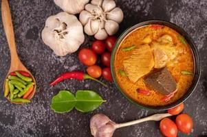 Chicken curry in a black cup photo