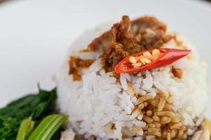 Crispy pork with sauce and chili split in half