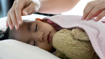 Asian Baby Girl Sleeping in Bed