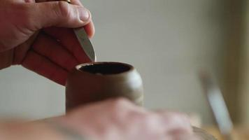 Potter Uses a Knife to Remove Excess Clay
