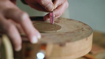 Potter Carves a Circle out Of Clay