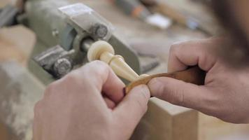Woodworker Polishing a Wooden Part