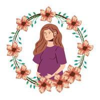 Linda mujer embarazada en el marco de la decoración de flores