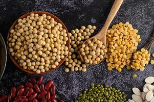 Legumes and beans assorted on a black cement surface