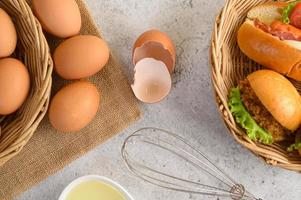 Fresh brown eggs and bakery products on a neutral background