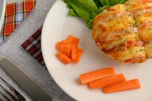 Sausage bread roll and carrots photo