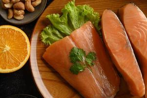 Salmon pieces on a wooden plate photo