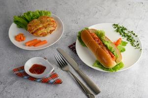 Appetizers with a sausage bread roll and hotdog