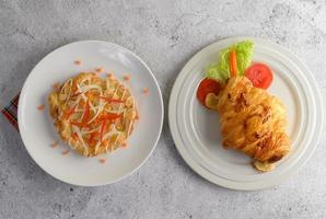 Appetizing almond twist bread and croissant