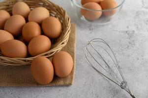 Fresh brown eggs in a wicker basket photo