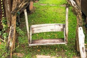 Wooden porch swing in garden photo