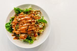 Salad with chicken and sauce