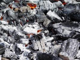 Coals burning for a fire photo